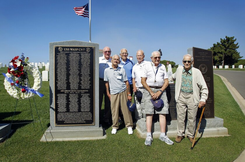 At a monument to the Wasp, six survivors of the doomed aircraft carrier: from left, Jim Forrester, Smitty Smith, Hal Sessions, Don Cruse, Jim Berry, and Joe Shelley