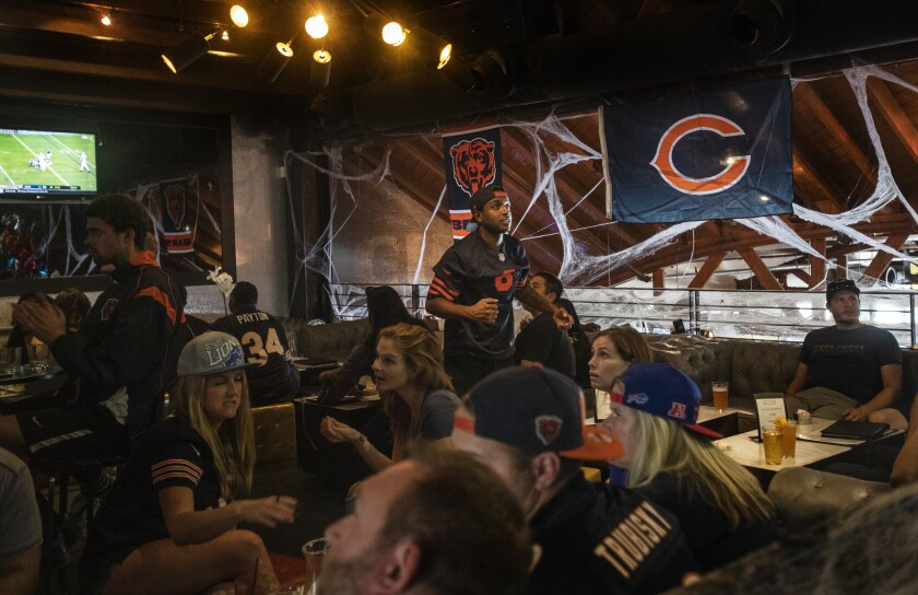 Chicago Bears fans gather in the clubby upstairs lounge at Rush Street.