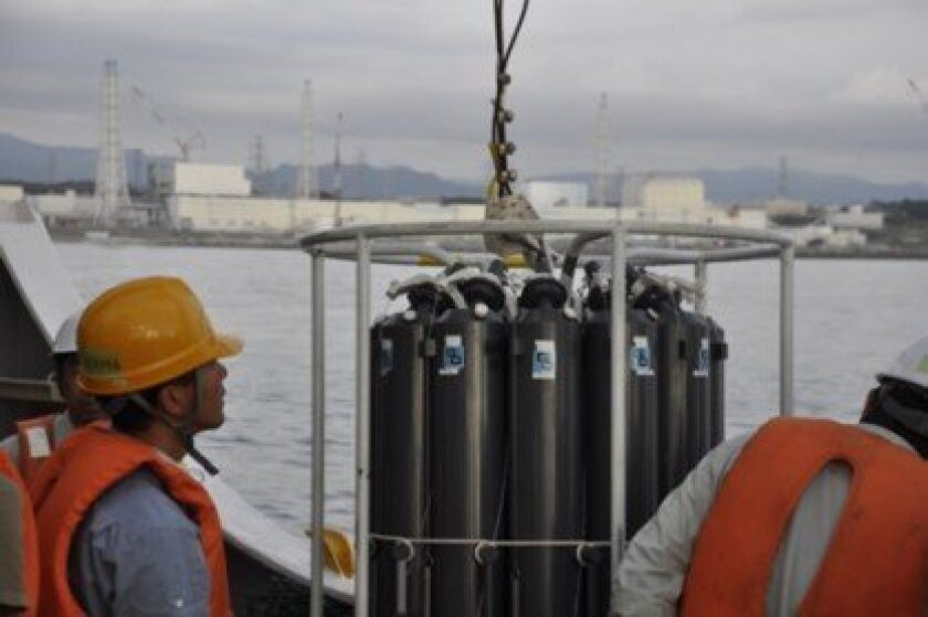 Scientists gather water samples in front of the Fukushima power plant in Japan.   Courtesy of Woods Hole Oceanographic Institution