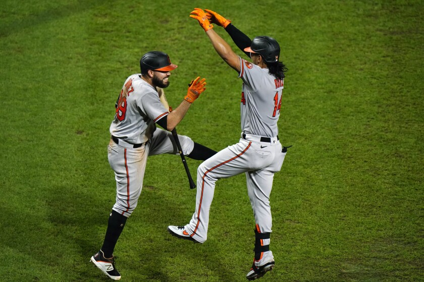 Baltimore Orioles' Rio Ruiz, right, and Renato Nunez celebrate after Ruiz's home run off Philadelphia Phillies pitcher Zach Eflin during the fifth inning of a baseball game, Wednesday, Aug. 12, 2020, in Philadelphia. (AP Photo/Matt Slocum)
