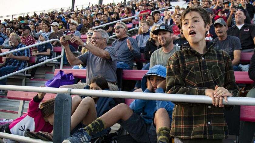 """IRWINDALE, CA - JUNE 15, 2019: Fans react to stunt races during the """"Summer Mayhem"""" event at the Ir"""
