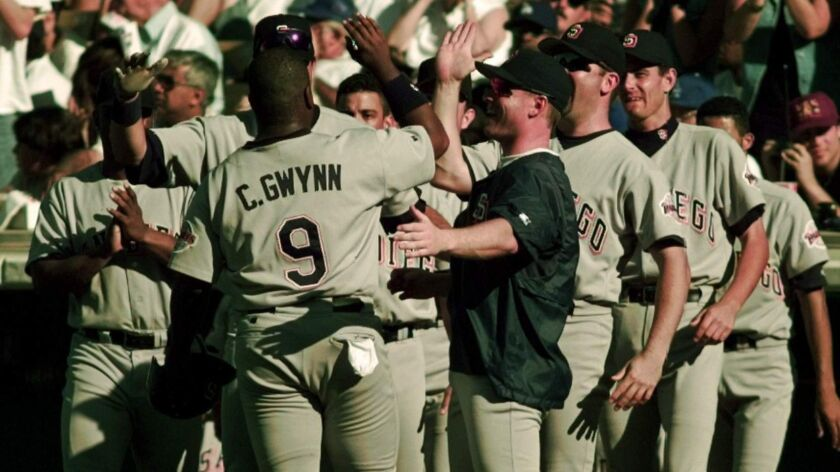 San Diego Padres' Chris Gwynn is congratulated by jubilant teammates after his 11th-inning, 2-RBI double gave the Padres a 2-0 win and the National League West title over the Los Angeles Dodgers, Sept. 29, 1996, in Los Angeles.