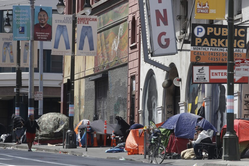 Tents occupied by homeless people line a sidewalk on Golden Gate Avenue in San Francisco.