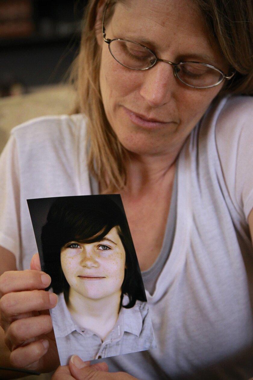 Katharine Prescott holds a photo of her late son, Kyler
