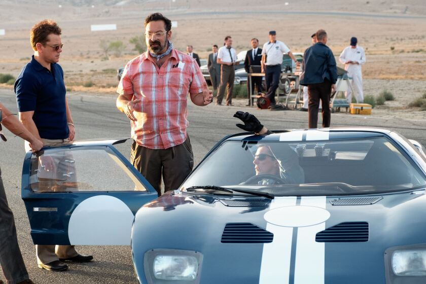 Ford v Ferrari is directed by James Mangold, flanked  here by actors Matt Damon and Christian Bale