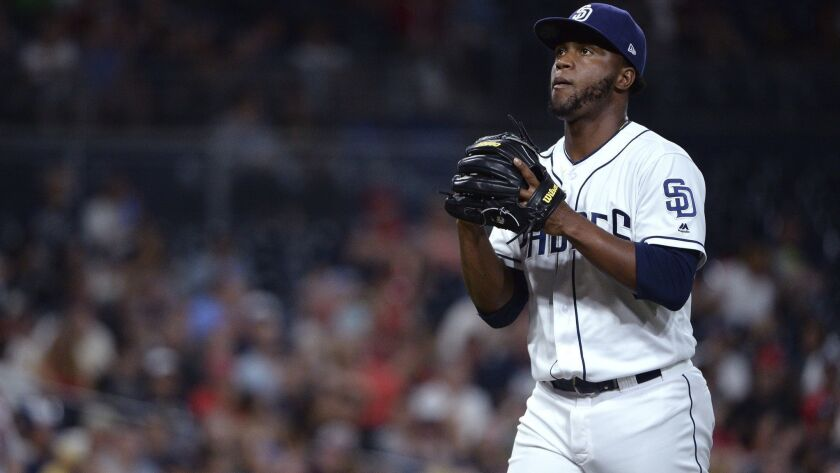San Diego Padres relief pitcher Miguel Diaz looks on as he walks off the field during the third inni