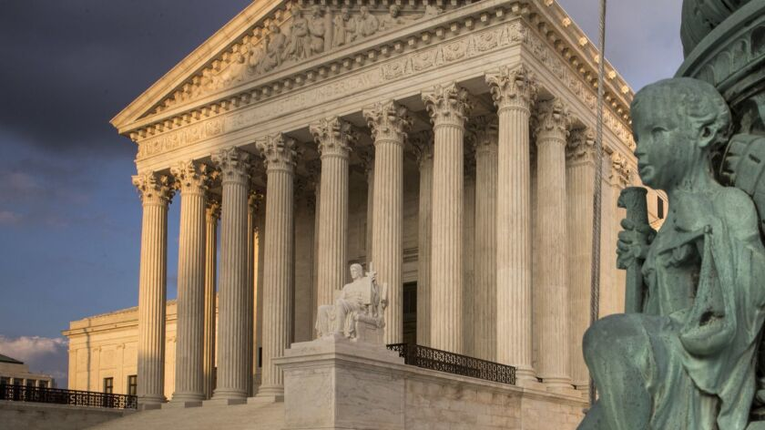 FILE - In this Oct. 10, 2017, file photo, the Supreme Court in Washington, at sunset. America's labo