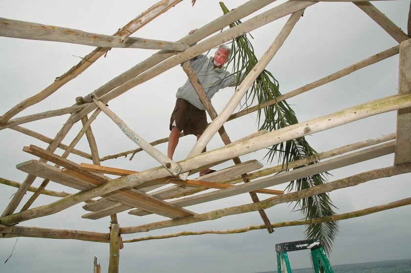 The late Mark Scales helped maintain the surf Shack at WindanSea with fresh palm fronds.