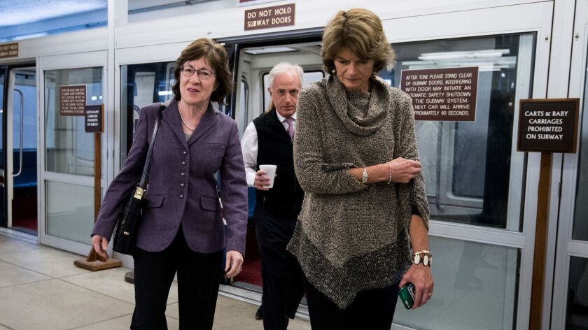 From left, GOP Sens. Susan Collins of Maine, Bob Corker of Tennessee and Lisa Murkowski of Alaska head to Senate Majority Leader Mitch McConnell's office after meeting with other Senate moderates.