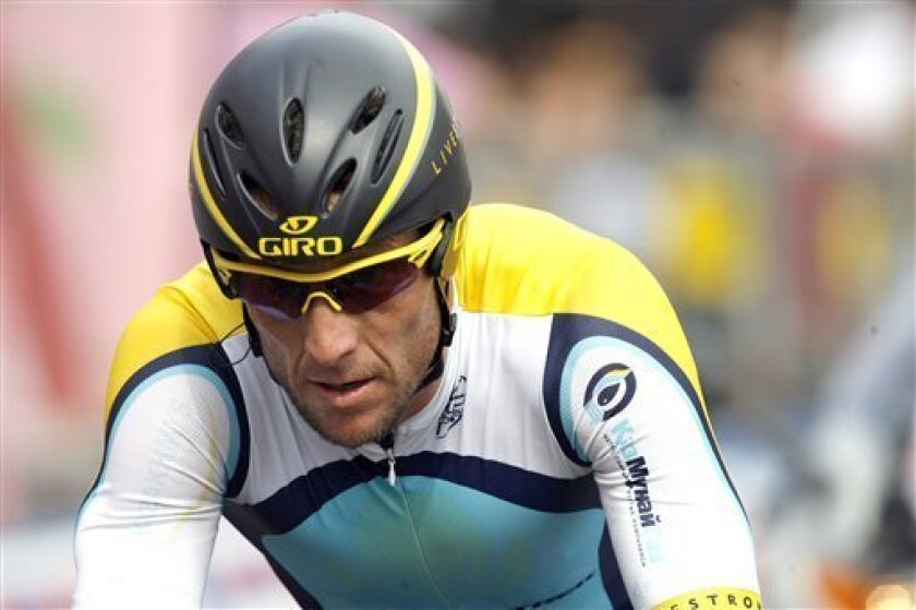 Lance Armstrong of the United States reacts during the final stage of the Giro d'Italia, Tour of Italy cycling race, an individual time trial in Rome Sunday, May 31, 2009. (AP Photo/Marco Trovati)