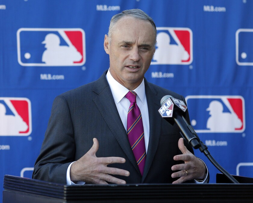 Rob Manfred, then MLB's commissioner-elect, speaks during a news conference at the owners meeting in Phoenix on Jan. 15.