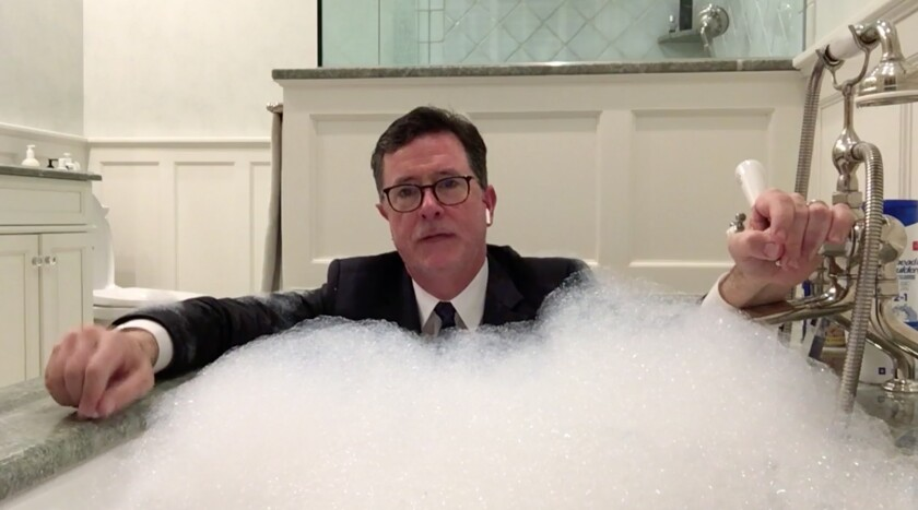 """Host Stephen Colbert in his bathtub during a social-distancing dispatch on """"The Late Show with Stephen Colbert."""""""