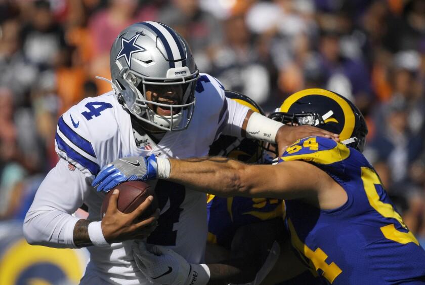 Dallas Cowboys quarterback Dak Prescott is sacked by Rams linebacker Bryce Hager during Saturday's preseason game.