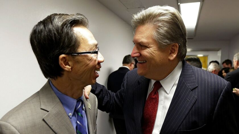 Assemblyman Ed Chau (D-Arcadia), left, and Sen. Bob Hertzberg (D-Van Nuys) celebrate after their internet privacy bill was approved by the Senate Judiciary Committee, in June 2018. Can they resist a business campaign to water it down?