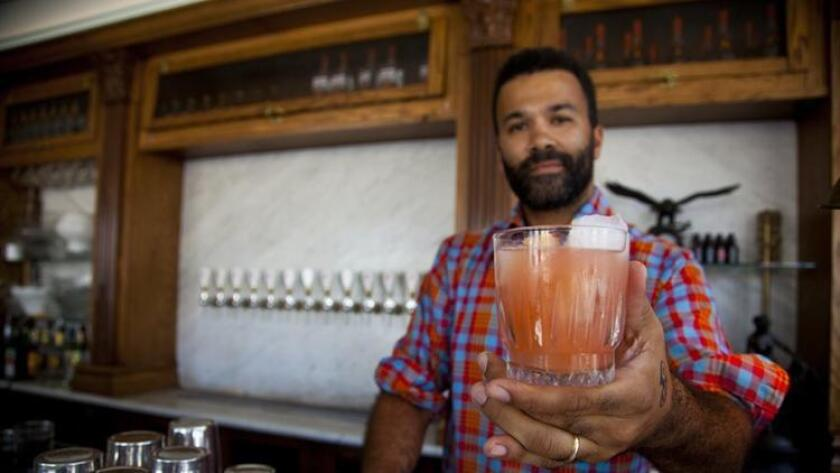 Aaron Zieske mixing up a Pine Street Sour (/ Jarnard Sutton)