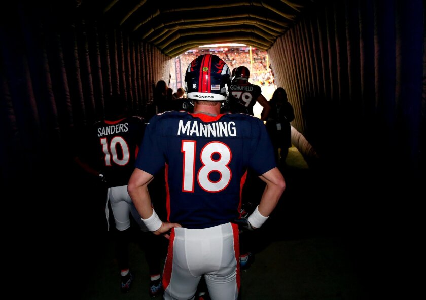Denver Broncos quarterback Peyton Manning (18) stands in the tunnel before player introductions prior to an NFL football game against the Green Bay Packers, Sunday, Nov. 1, 2015, in Denver. (AP Photo/Jack Dempsey)