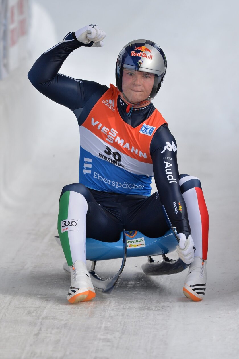 First placed Dominik Fischnaller from Italy celebrates in the finish area of the men's luge World Cup race inInsbruck Igls, Austria, Sunday, Nov. 29, 2015. (AP Photo/Kerstin Joensson)