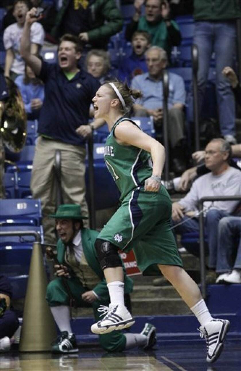 Notre Dame guard Natalie Novosel celebrates late in the second half of Notre Dame's 73-59 win over Tennessee in an NCAA women's college basketball tournament regional final, Monday, March 28, 2011, in Dayton, Ohio. (AP Photo/Al Behrman)