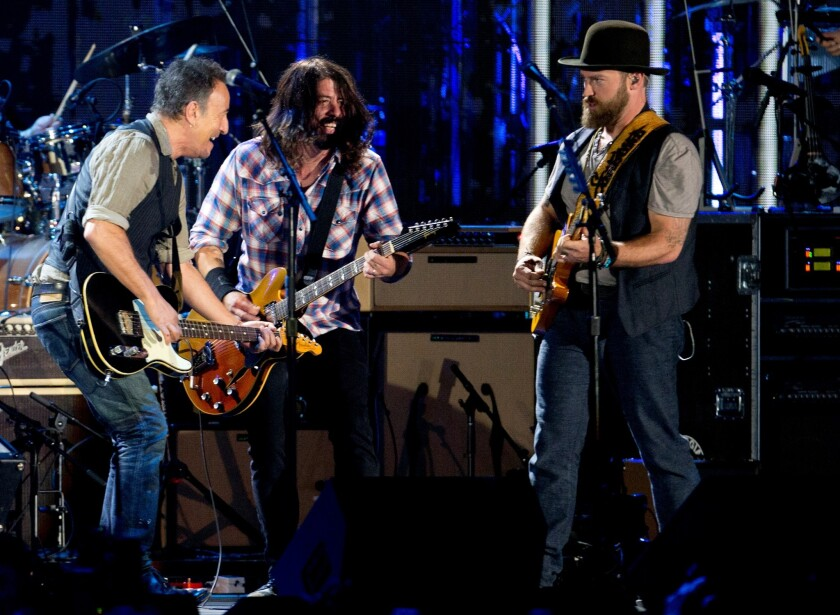 Bruce Springsteen, left, Dave Grohl, and Zac Brown perform Tuesday, Nov. 11, 2014, at the Concert for Valor.