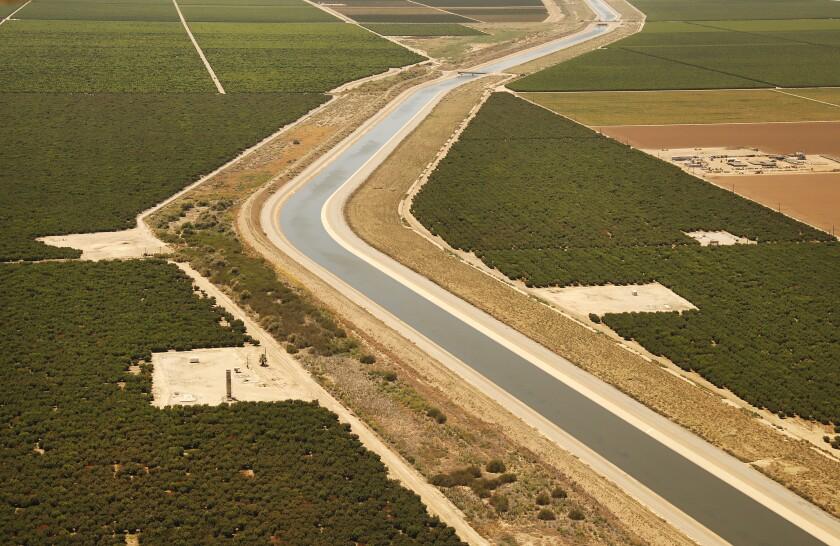 The California Aqueduct runs through farmland in Kern County.