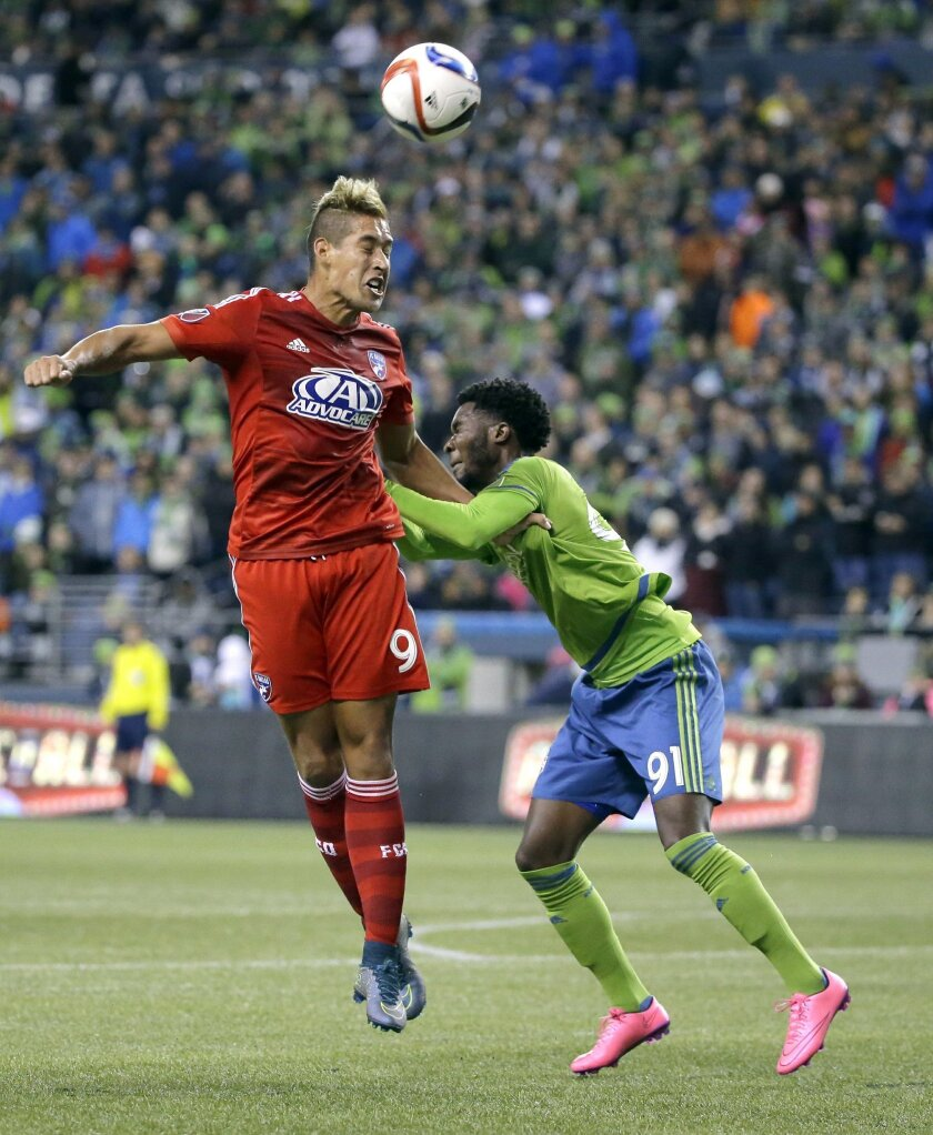 Seattle Sounders defender Oniel Fisher, right, and FC Dallas forward David Texeira (9) battle for a header in the first half of an MLS soccer western conference semifinal playoff match, Sunday, Nov. 1, 2015, in Seattle. (AP Photo/Ted S. Warren)