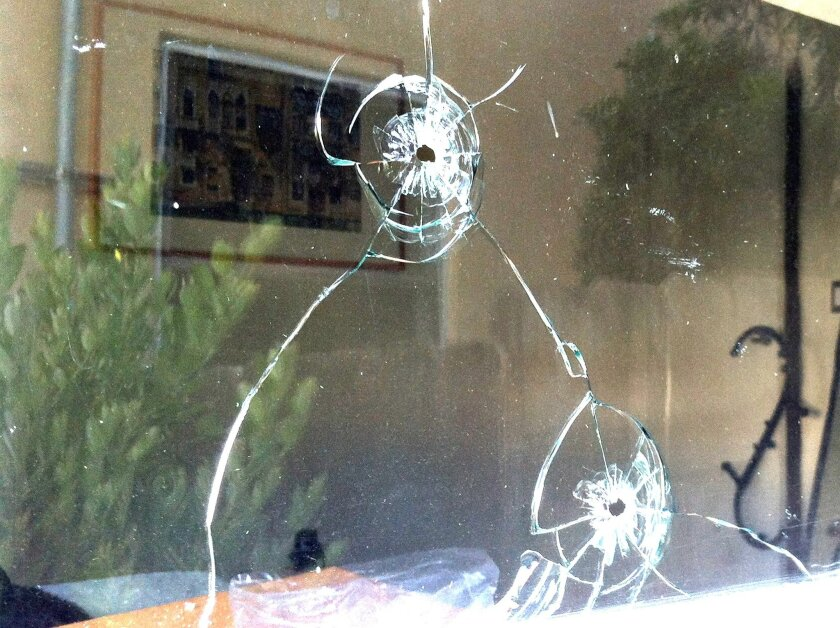 Damage from a June 28 shotgun attack on a home at the corner of Draper Avenue and Fern Glen. Courtesy photos