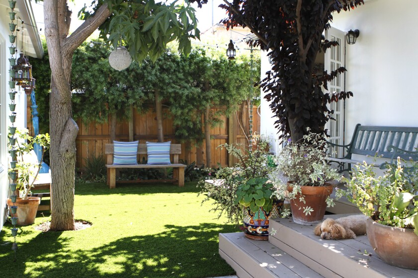 This Venice home has artificial turf instead of grass in the backyard.