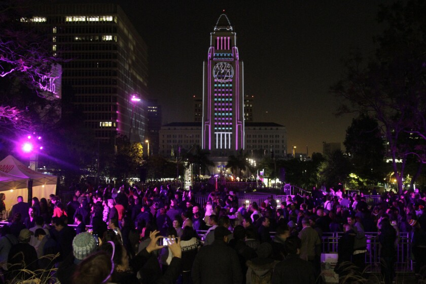 Revelers enjoy 2013's New Year's Eve festivities in downtown's Grand Park, where Live Nation is in discussions to stage a multi-day music festival.