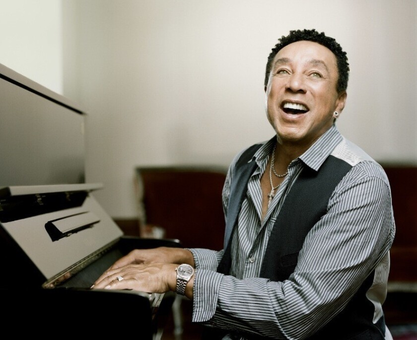 Smokey Robinson accompanies himself on the piano as he sings.