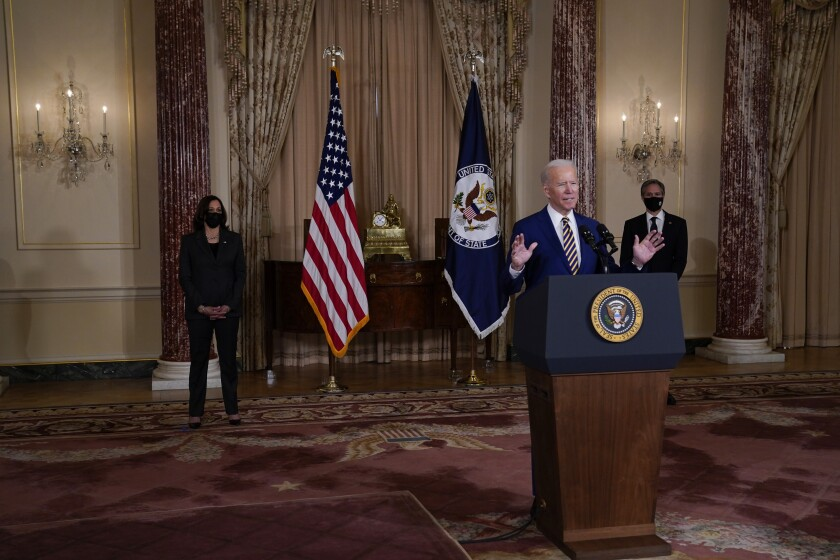 Vice President Kamala Harris, left, and Secretary of State Antony Blinken, right, listen as President Joe Biden delivers a speech on foreign policy, at the State Department, Thursday, Feb. 4, 2021, in Washington. (AP Photo/Evan Vucci)