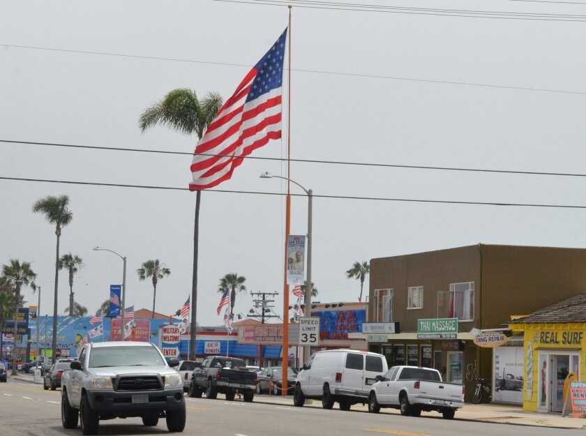 A huge American flag that flew outside a South Oceanside auto dealership was stolen last week by a thief on a skateboard. The owner, Loren Ritter, replaced the flag with a new one while police look for the suspect.