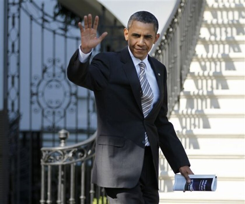President Barack Obama waves as he leaves the White House in Washington, Friday, July 1, 2011, for Camp David, Md. (AP Photo/Manuel Balce Ceneta)