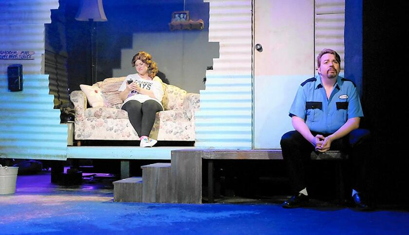 Playing the frustrated couple whose marriage is approaching the rocks are Jon Sparks and Elizabeth Bouton.