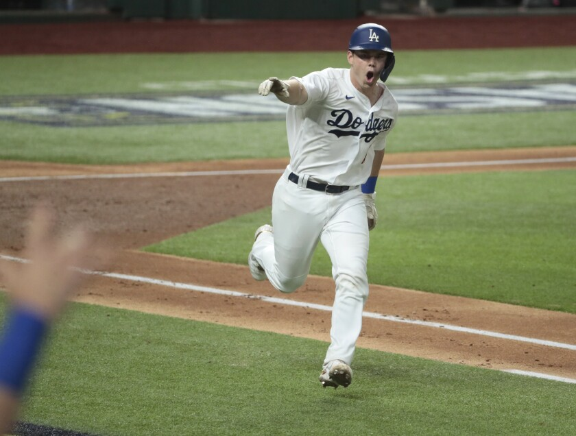 Dodgers catcher Will Smith reacts after hitting a two-run single in Game 7 of the NLCS.