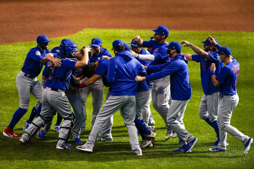 Chicago Cubs pitcher Alec Mills is swarmed by his teammates after throwing a no-hitter against the Milwaukee Brewers.