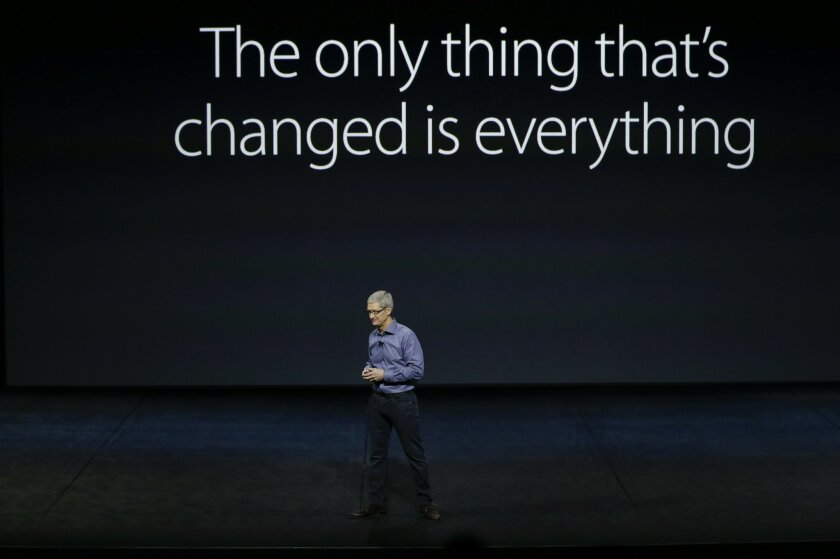 FILE - In this Wednesday, Sept. 9, 2015, file photo, Apple CEO Tim Cook discusses the new iPhone 6s and iPhone 6s Plus during the Apple event at the Bill Graham Civic Auditorium in San Francisco. Apple has spent years setting itself up as the champion of individual privacy and security, a decision