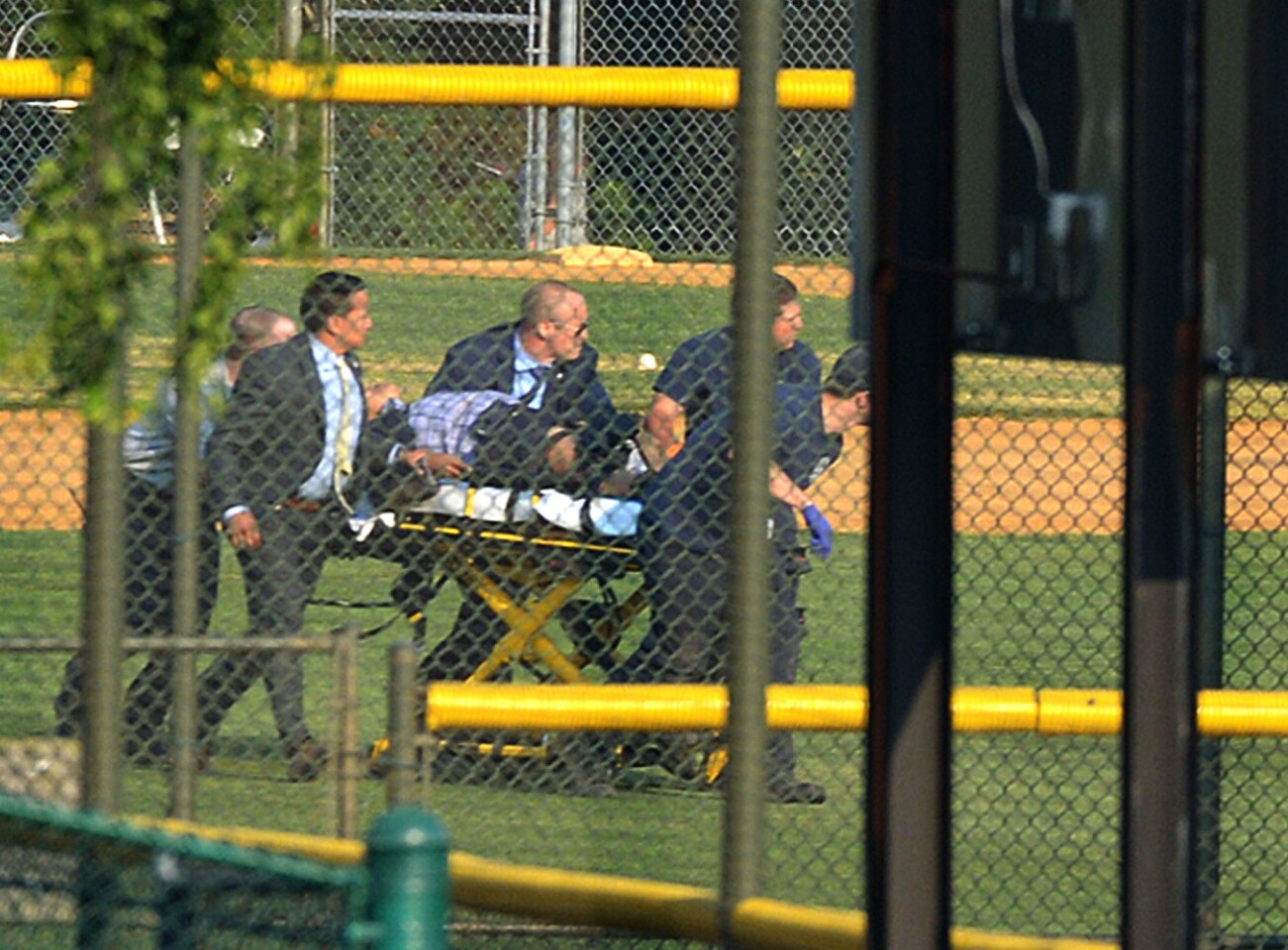 A unidentified shooting victim is rushed to a helicopter after a gunman open fire at a Republican congressional baseball practice Wednesday morning in Alexandria.
