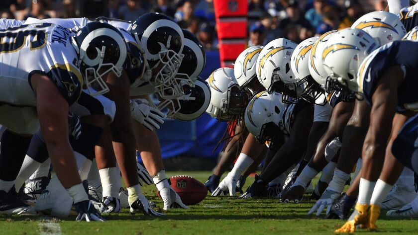 The Los Angeles Chargers and the Los Angeles Rams line up for a play during the first half of a pres