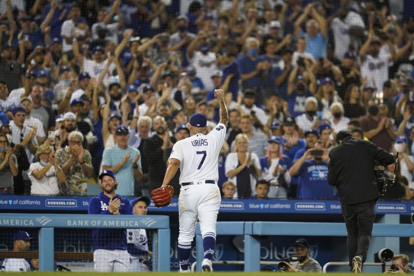 Los Angeles Dodgers relief pitcher Julio Urias (7) raises his fist as he leaves the mound during the seventh inning of a baseball game against the Milwaukee Brewers Saturday, Oct. 2, 2021, in Los Angeles. (AP Photo/Ashley Landis)
