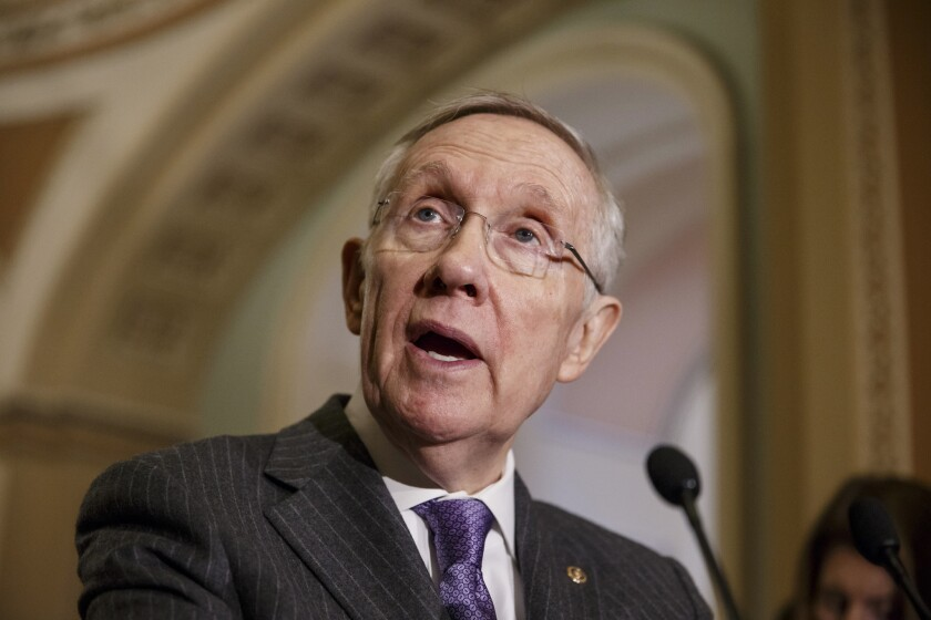 Senate Majority Leader Harry Reid of Nevada talks to reporters Tuesday on Capitol Hill.