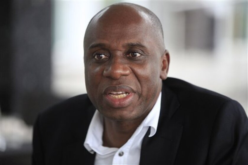 CORRECTION REMOVES REFERENCE TO POPULATION - Rivers state governor, Rotimi Chibuike Amaechi, speaks to foreign journalist in Lagos, Nigeria, Monday Sept. 2, 2013. The governor says that a new splinter group he formed within the ruling party along with six other governors and a former presidential candidate are trying to pressure the party to do more about poverty, crime and education. The move is the first major internal challenge to President Goodluck Jonathan since he was elected in 2011. Gov.