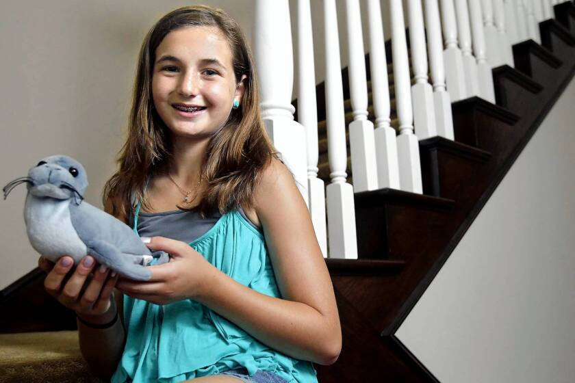 Julia Wolfe, 12, of Newport Beach is hosting a fundraiser this Sunday for the Pacific Marine Mammal Center.