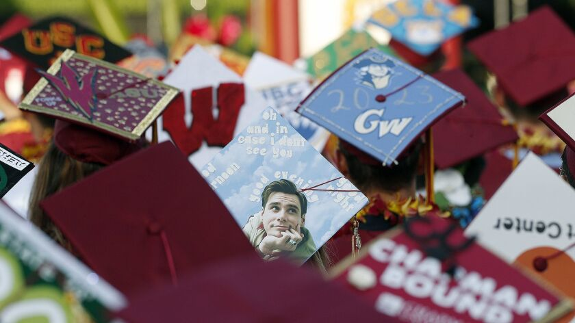 Most graduating seniors decorated their mortar boards with the schools they plan to attend at the gr
