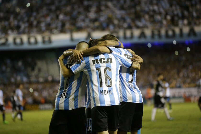 Argentina's Racing players celebrate after defeating Mexico's Puebla 1-0 during a Copa Libertadores soccer match in Buenos Aires, Argentina, Wednesday, Feb. 10, 2016.  (AP Photo/Victor R. Caivano)
