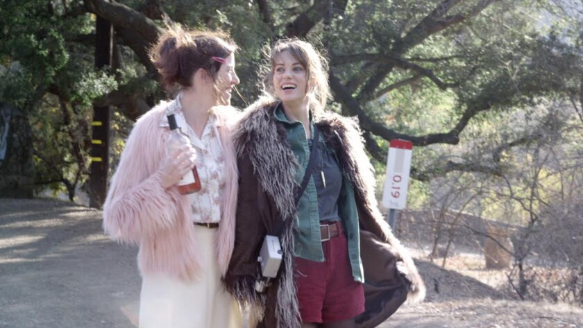 "Kristin Wallace, left, and Lyndsy Fonseca in the movie ""Moments of Clarity."""