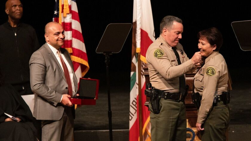 MONTEREY PARK, CA-DECEMBER 3, 2018: left to right-Los Angeles Count Sheriff's Deputy Caren Carl Mand