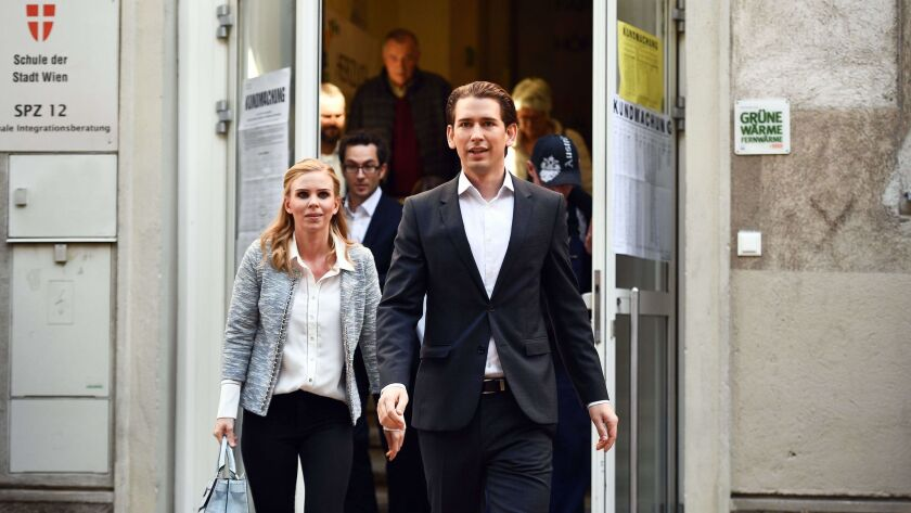 Austrian Foreign Minister Sebastian Kurz and his girlfriend, Susanne Thier, leave a polling station after casting their votes in the Austrian Federal Elections in Vienna on Sunday.