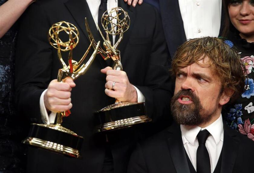 Peter Dinklage poses with the cast and crew of 'Game of Thrones', winner of the Outstanding Drama Series Award, in the press room during the 68th annual Primetime Emmy Awards ceremony held at the Microsoft Theater in Los Angeles, California. EFE/EPA/FILE