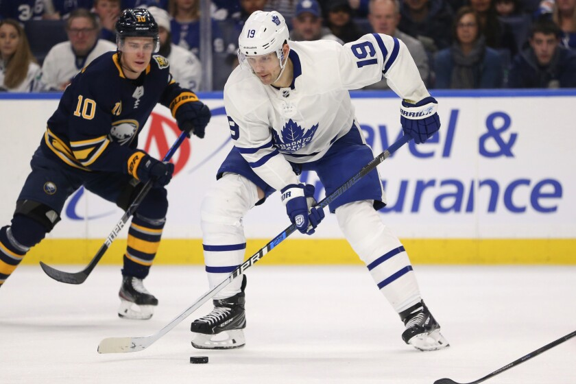 FILE - In this Sunday, Feb. 16, 2020 file photo, Toronto Maple Leafs forward Jason Spezza (19) controls the puck during the second period of the team's NHL hockey game against the Buffalo Sabres in Buffalo, N.Y. Jason Spezza's confidence in the NHL returning wasn't shaken by word of 11 players testing positive for the coronavirus. Given his involvement in Players' Association talks, the veteran Toronto forward knew from doctors' input that there would be positive test results in hockey just as there have been in other sports as group workouts ramp up across North America.(AP Photo/Jeffrey T. Barnes, File)