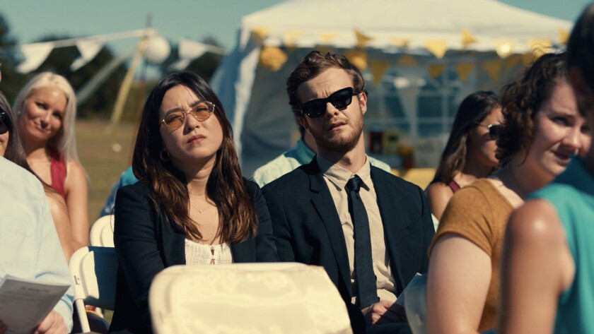 (L-R)- Maya Erskine as Alice and Jack Quaid as Ben in the romantic comedy ?PLUS ONE,? an RLJE Films